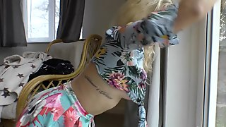 Naughty blonde chick cleans the windows with downblouse