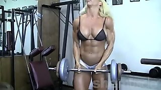 Blonde Female Bodybuilder in See Thru Top Works Out Hard