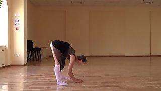 Super flexible Tonya making gymnasts positions before the camera.